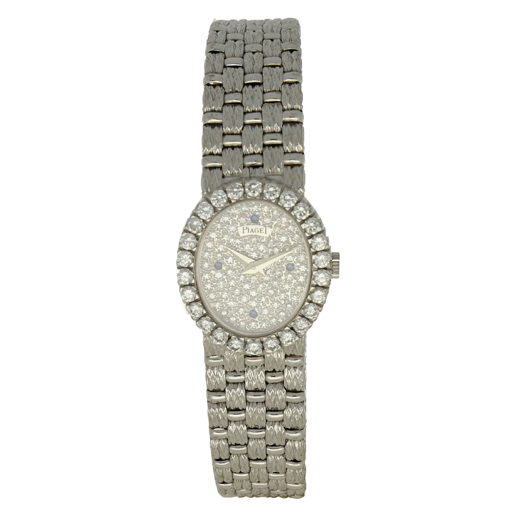 18ct white gold 'oval cased' bracelet watch with diamond and sapphire set dial and diamond set bezel. Circa 1970