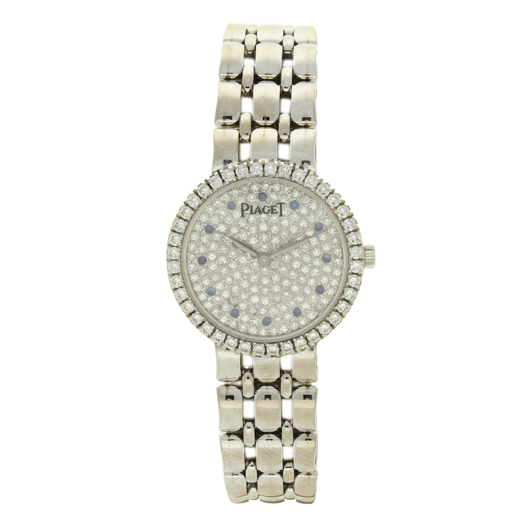18ct white gold 'round cased' bracelet watch with diamond set dial and bezel. Circa 1970