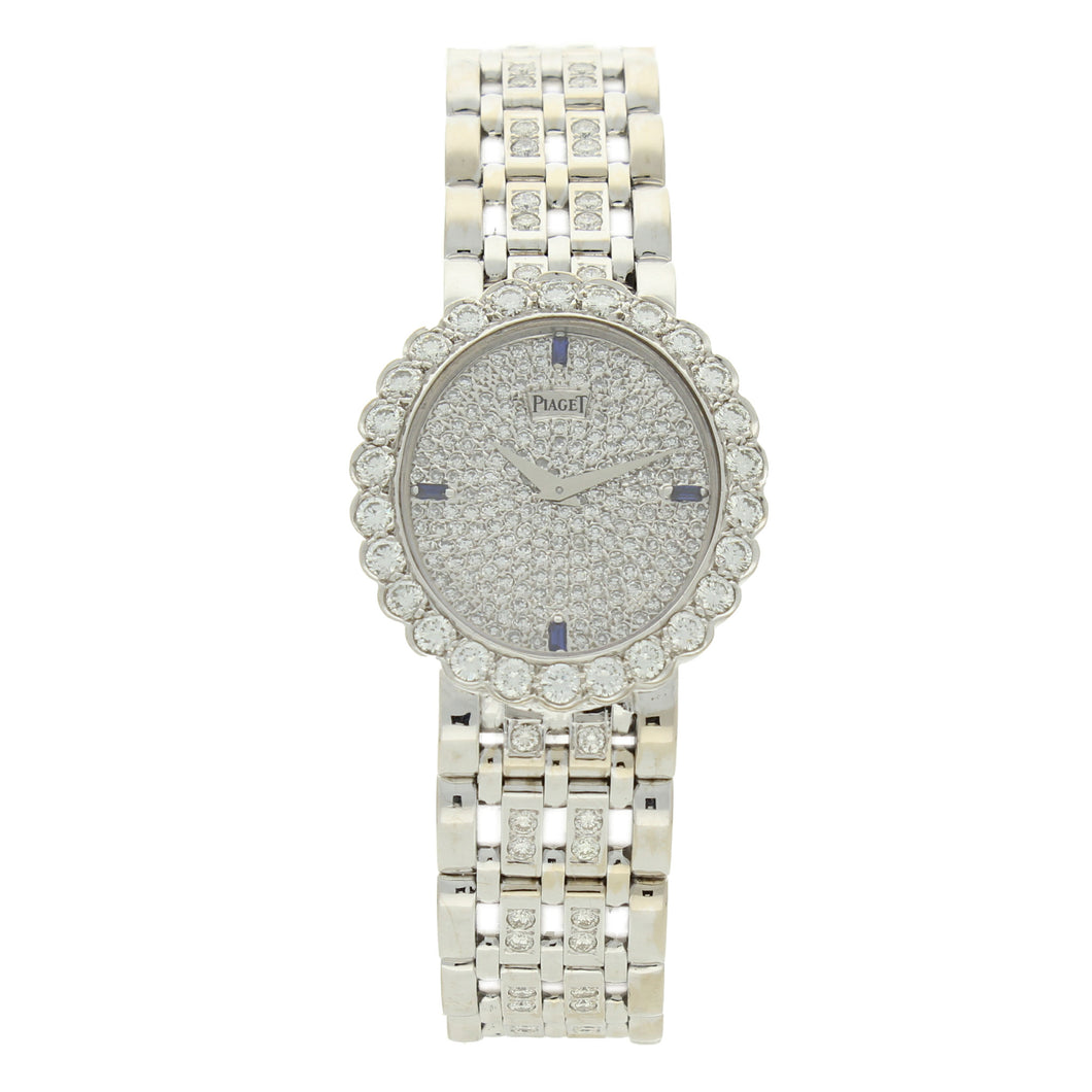 18ct white gold 'oval cased' bracelet watch with diamond and sapphire set dial. Circa 1970
