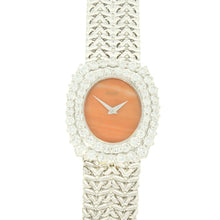 Load image into Gallery viewer, 18ct white gold 'oval cased' bracelet watch with coral dial and diamond set bezel. Circa 1970