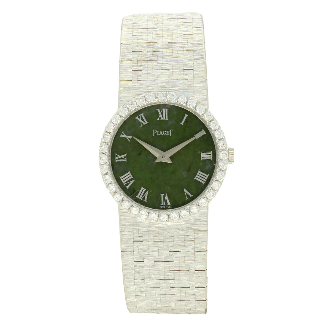 18ct white gold 'round cased' bracelet watch with jade dial and diamond set bezel. Circa 1970