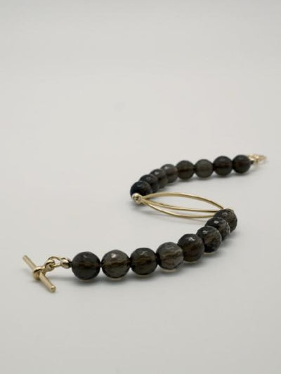 matte gold cocoon bracelet with smokey quartz stones by vivien walsh