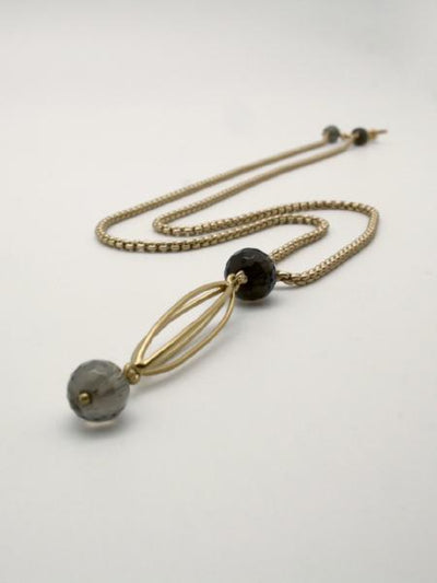 cocoon pendant matte gold with smokey quartz stones by vivien walsh