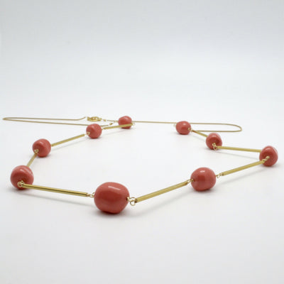 long necklace with matte gold tubes + coral nuggets