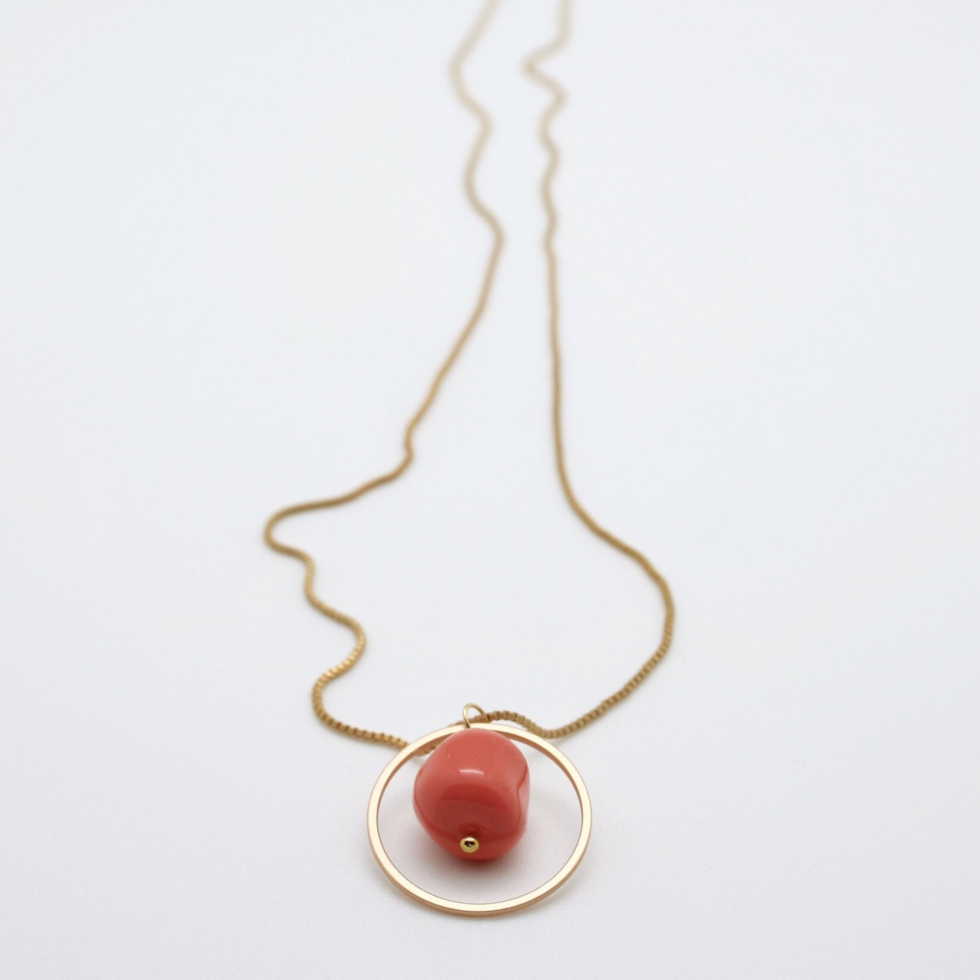 matte gold circle pendant with coral nugget drop