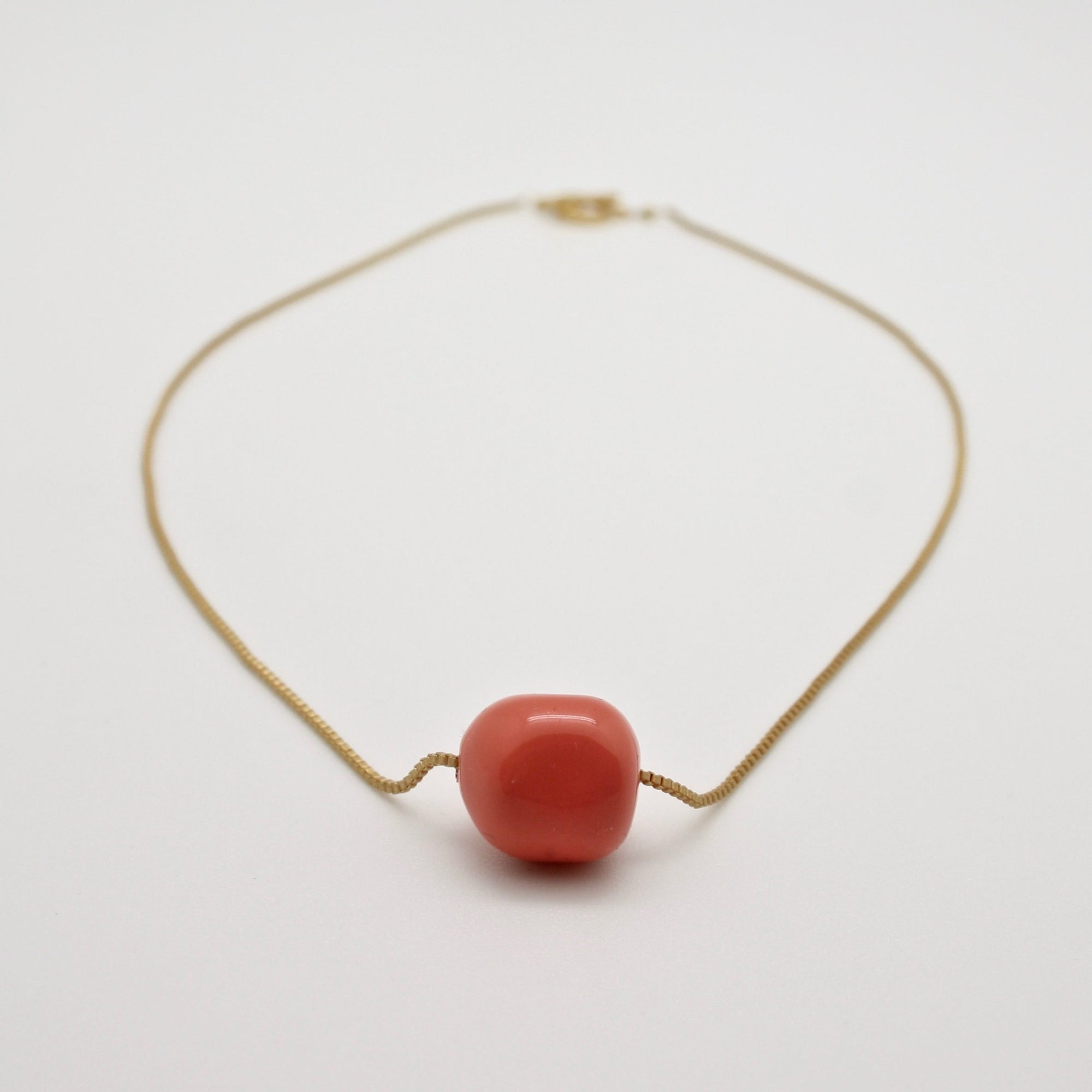 single coral nugget necklace on fine gold box chain
