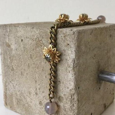 matte gold filigree flower bracelet with grey agate vivien walsh irish designer