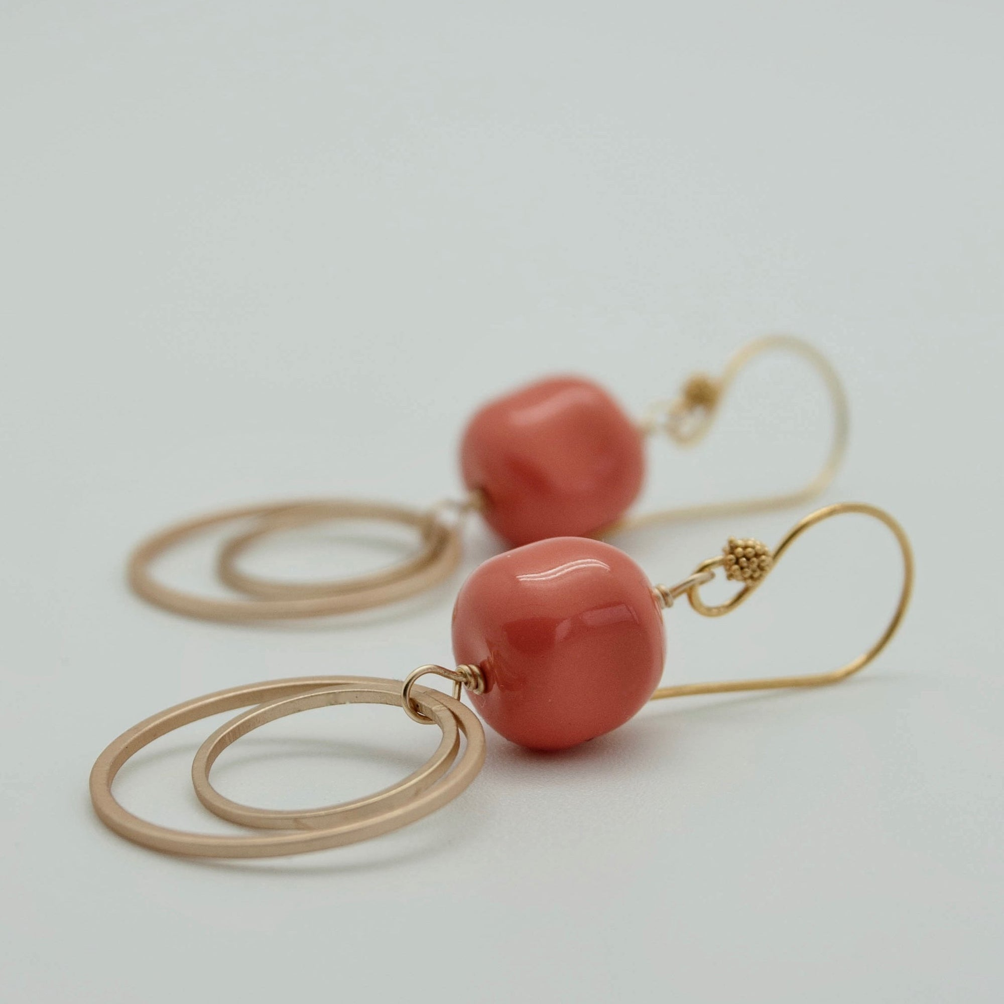matte gold double circle earrings with coral nuggets