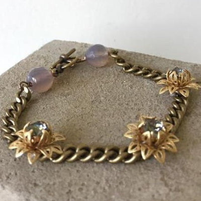 filigree flower bracelet on bronze curb chain with grey agate