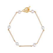 matte gold bar bracelet with white Swarovski crystal pearls by vivien walsh