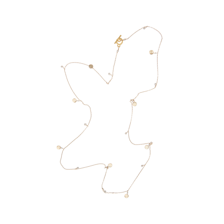 gold filled long charm chain with wavy discs and white pearls by vivien walsh