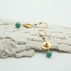 gold disc earrings with jade bead lying on decorative plasterwork bark by vivien walsh