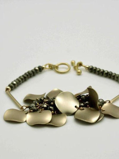 matte gold wavy disc bracelet by vivien walsh irish designer