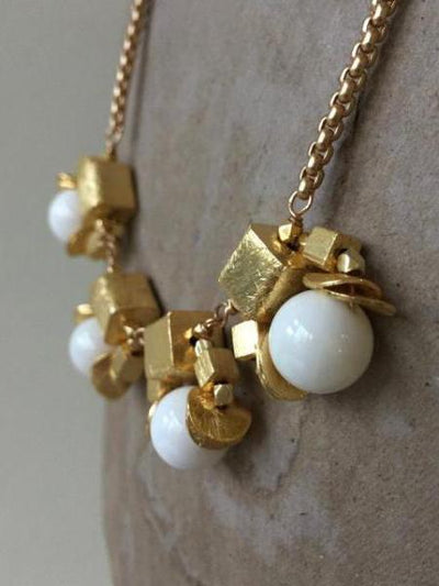 contemporary gold cube necklace with white vivien walsh