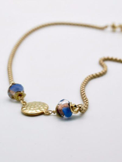 matte gold hammered disc necklace with blue glass beads