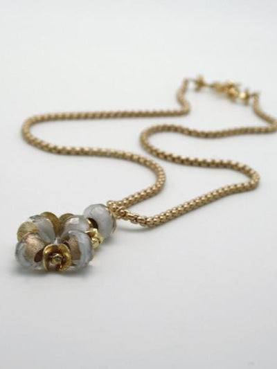 white glass bead pendant on matte gold chain