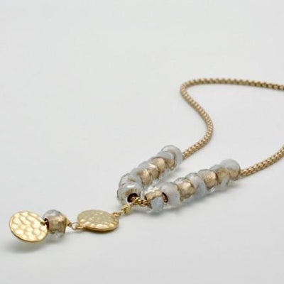 white and gold glass bead necklace with matte gold textured disc