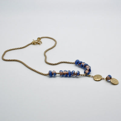 blue glass bead pendant with matte gold textured disc by vivien walsh
