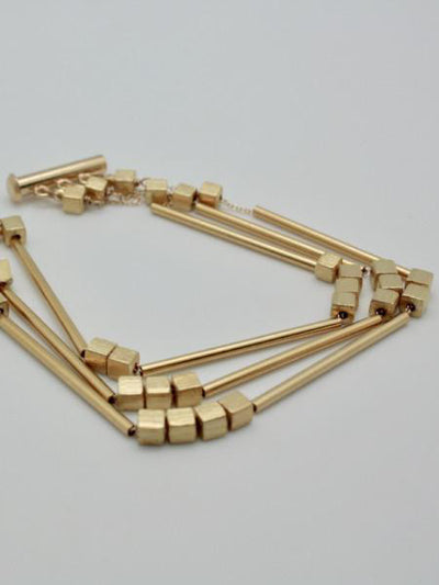 matte gold cuff with tubes at vivien walsh