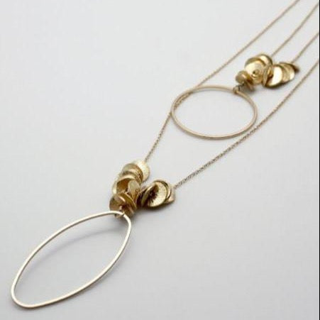 gold double chain necklace with oval drop lying flat