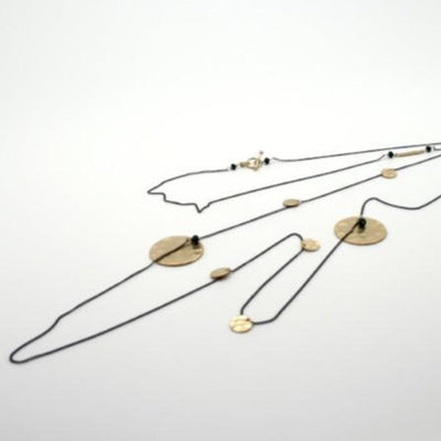 long gunmetal chain with gold plated hammered discs by vivien walsh