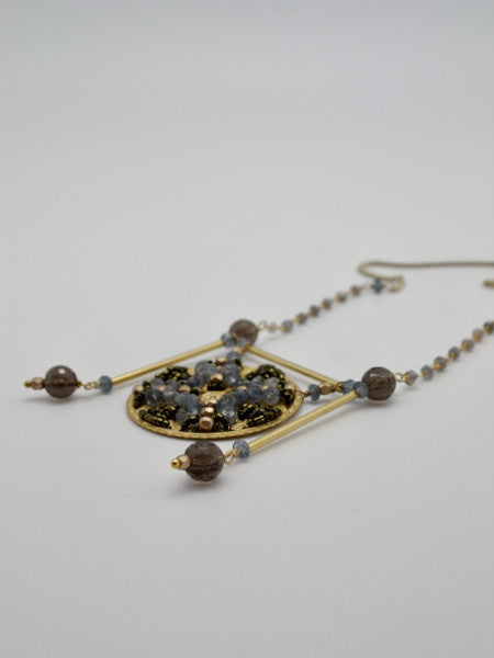 matte gold filigree embellished disc pendant by vivien walsh