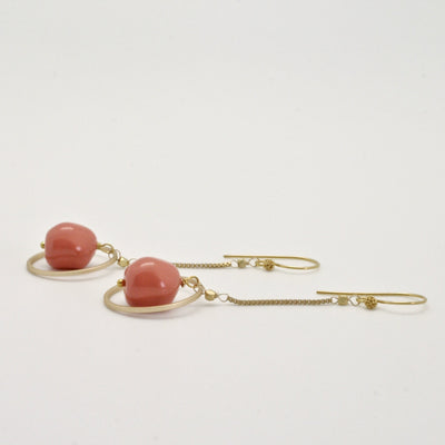 coral + gold chain earrings lying flat