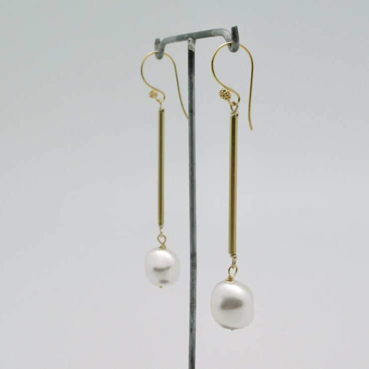modern gold tube earrings with pearl nugget drops