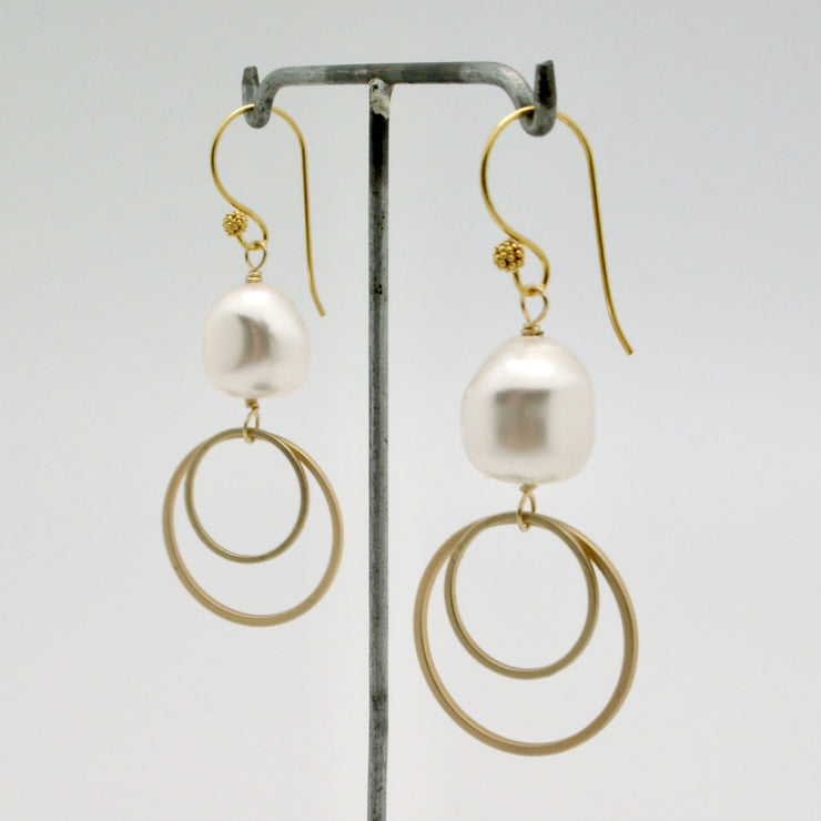 vivien walsh matte gold double circle earrings with pearls hanging on stand