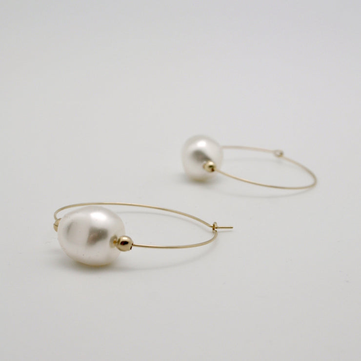 white baroque pearl nugget hoop earrings lying flat