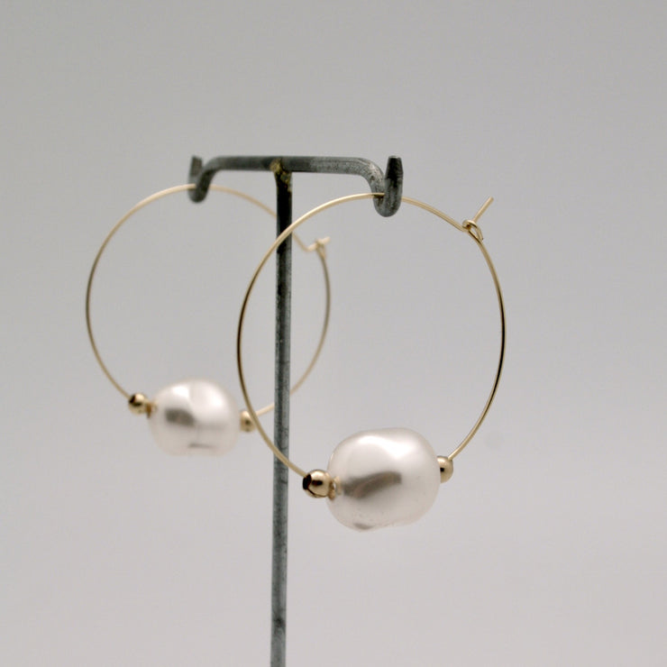 baroque pearl nugget hoop earrings in white on stand