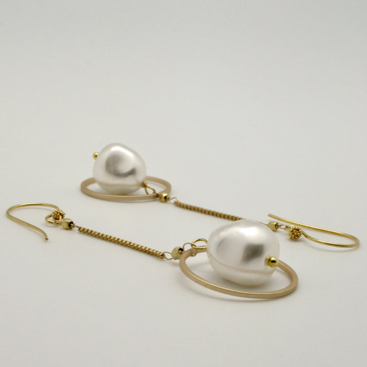 matte gold chain earrings with white baroque nugget pearls within matte gold circles