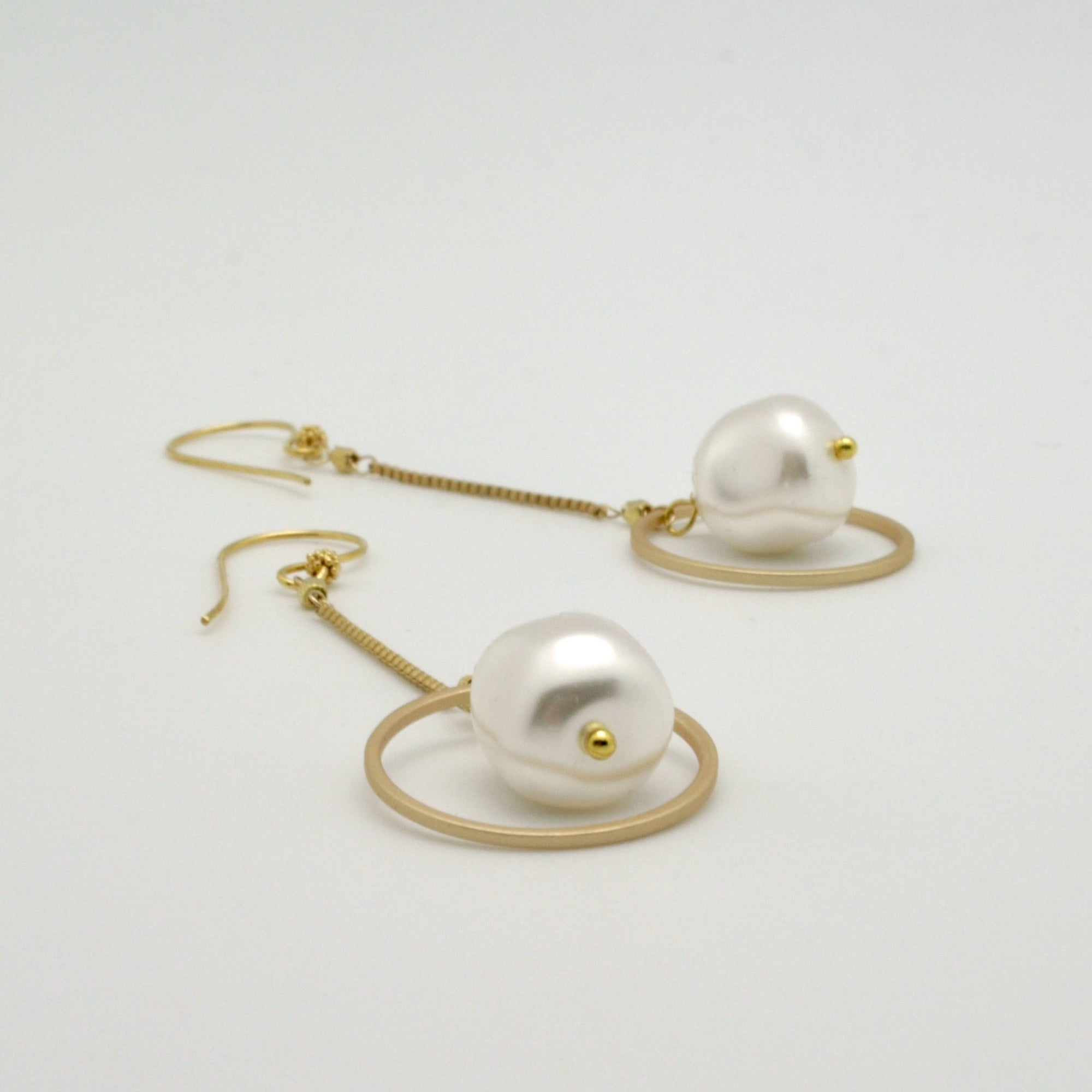 baroque pearl nugget earrings with matte gold circles + fine box chain lying flat