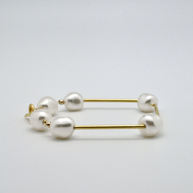 pearl and gold tube bracelet by vivien walsh