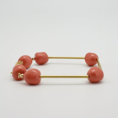 gold tube bracelet with coral nuggets