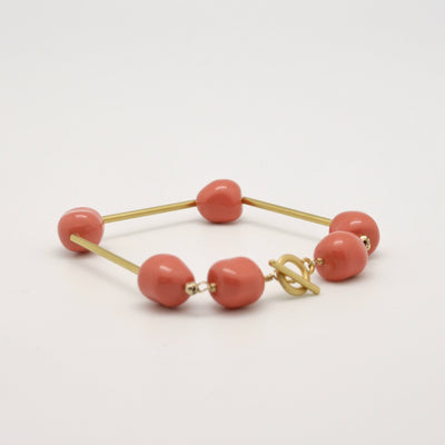 coral and gold tube modern bracelet