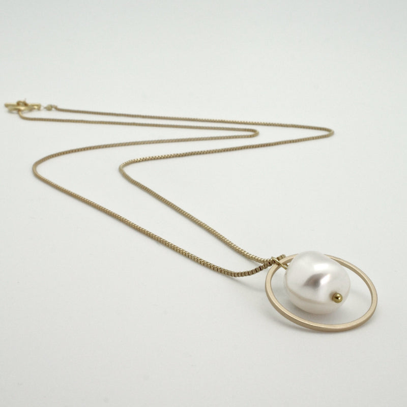 pearl nugget in a circle pendant