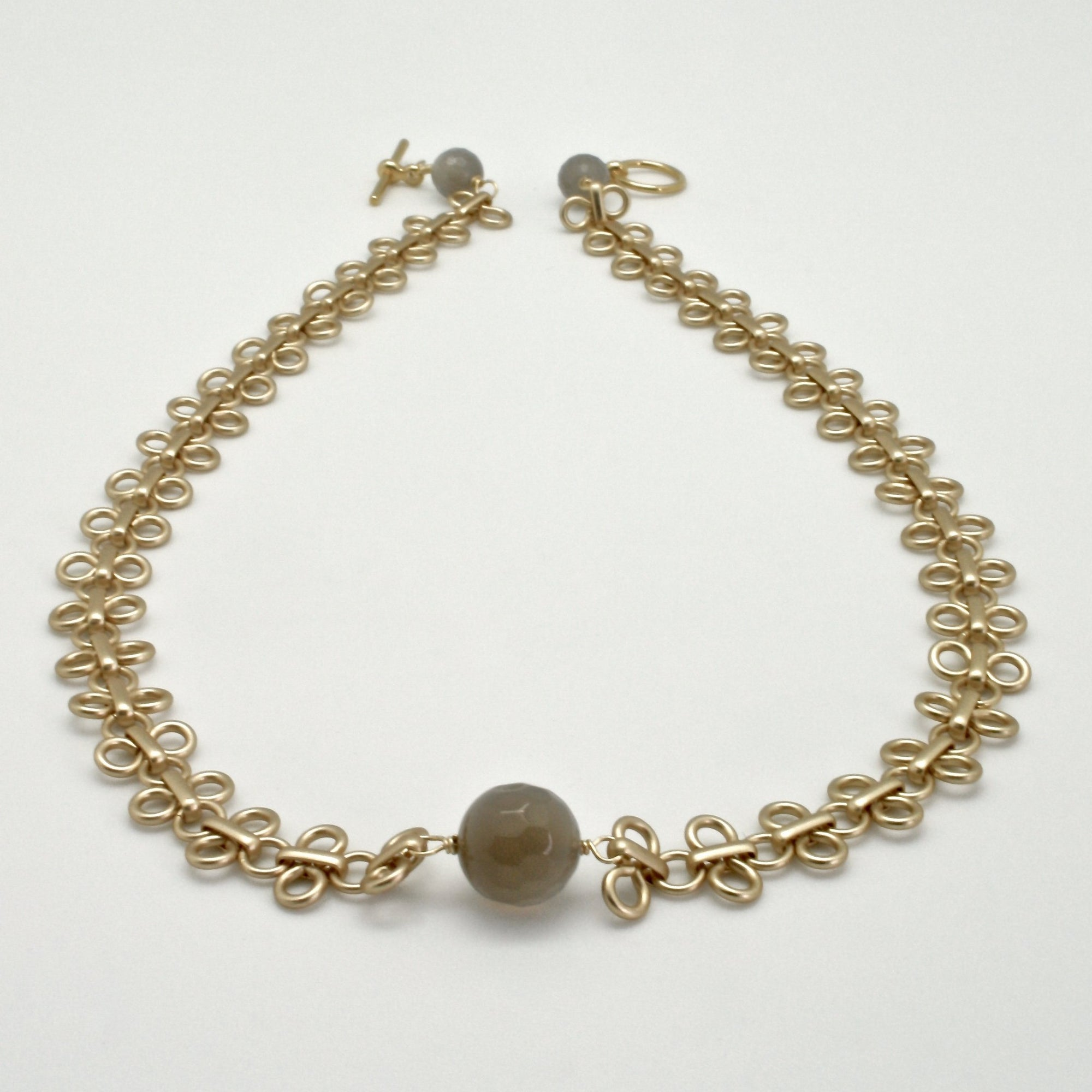 matte gold link collar with grey agate stones