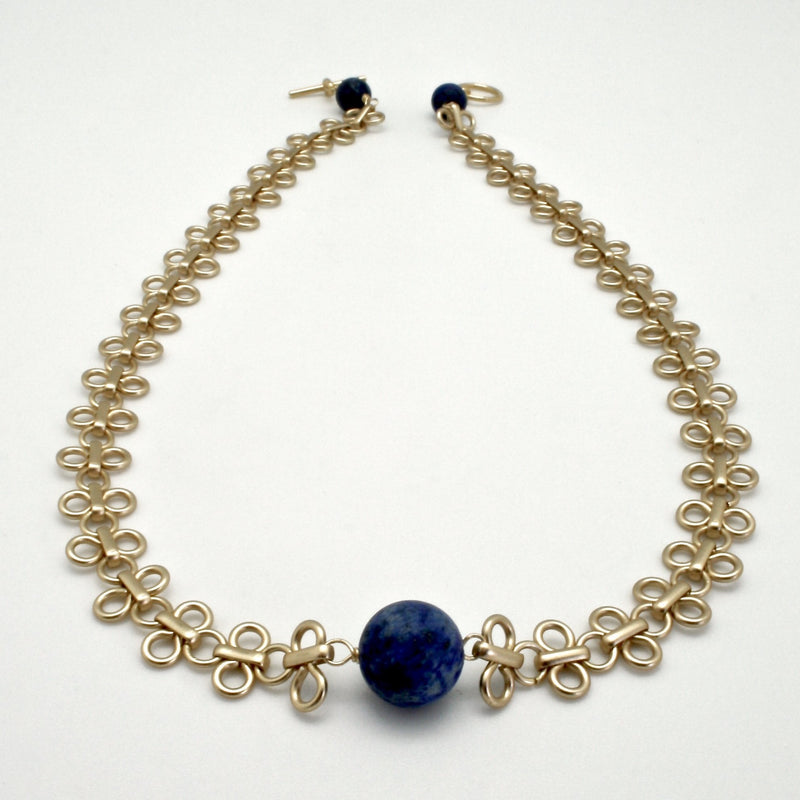 matte gold link collar with lapis centre stone by vivien walsh