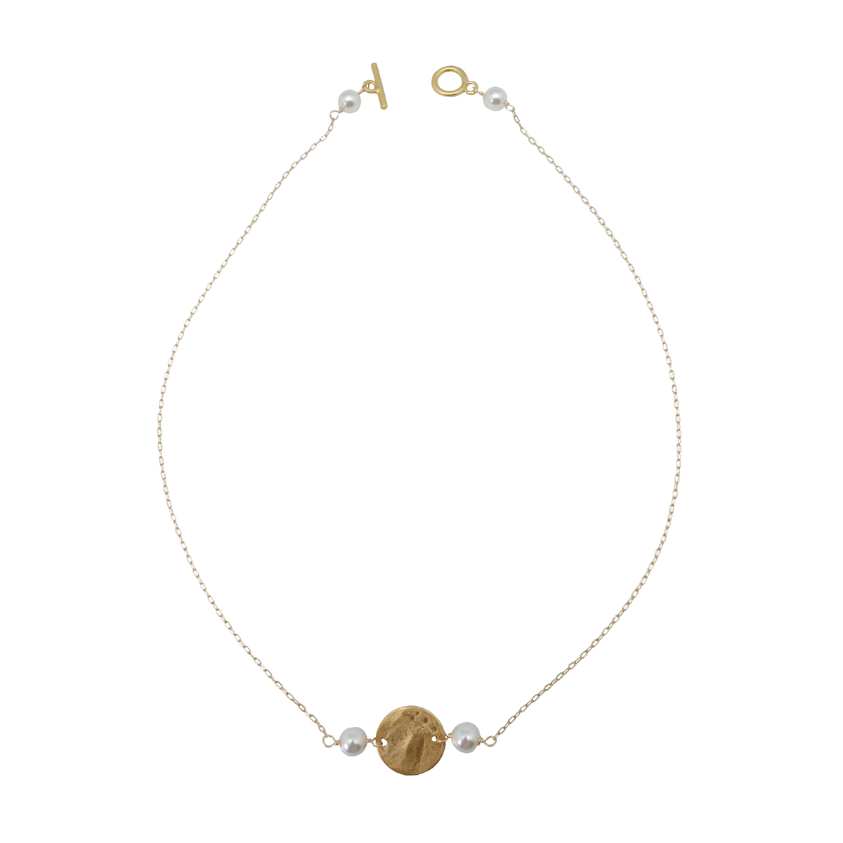 gold disc necklace with white pearls on white background