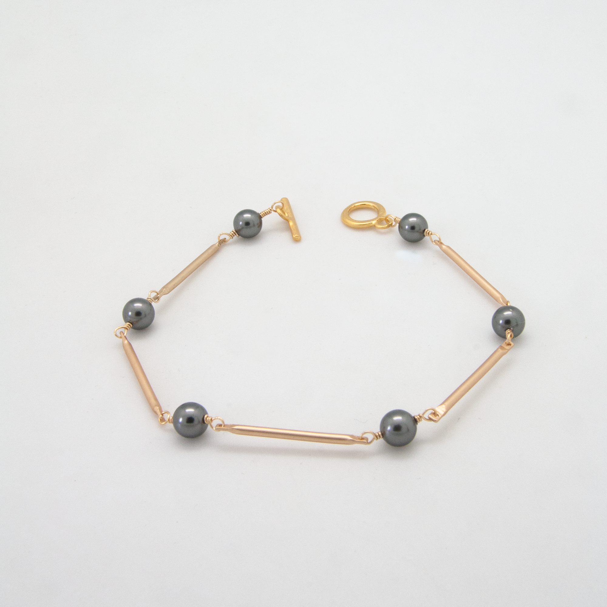 Matte gold bar bracelet with Swarovski crystal grey pearls by vivien walsh