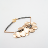 Matte gold ripple disc bracelet with grey pearls