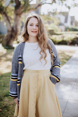 button-down skirt in mustard