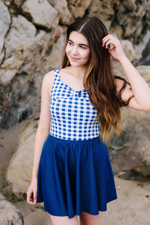 celia in gingham top