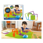 Child playing with a Code & Go Robot Mouse Activity Set