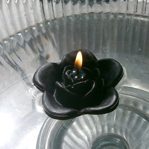 black colored rose shaped floating candle for wedding reception centerpieces
