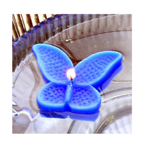 set of eight blue butterfly shaped floating wedding candles for reception centerpieces