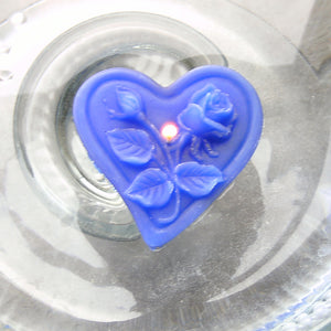 blue floating heart candle with rose motif for wedding reception centerpieces