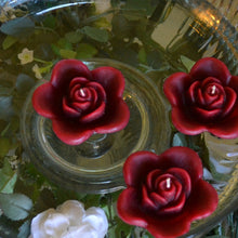Load image into Gallery viewer, burgundy deep red colored rose shaped floating candle for wedding reception centerpieces