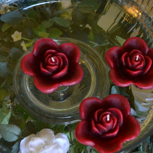 burgundy deep red colored rose shaped floating candle for wedding reception centerpieces